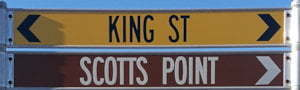 Brown sign for Scotts Point, street sign for King St
