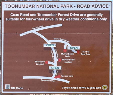 Brown sign for Toonumbar National Park locations, including Iron Pot Rest Area, Murray Scrub Walk, Murray Scrub Lookout, and Sherwood Lookout