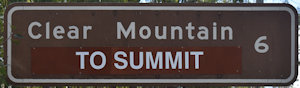 Brown sign for Clear Mountain, To Summit