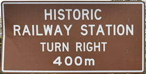 Brown sign for Historic Railway Station, turn right, 400m