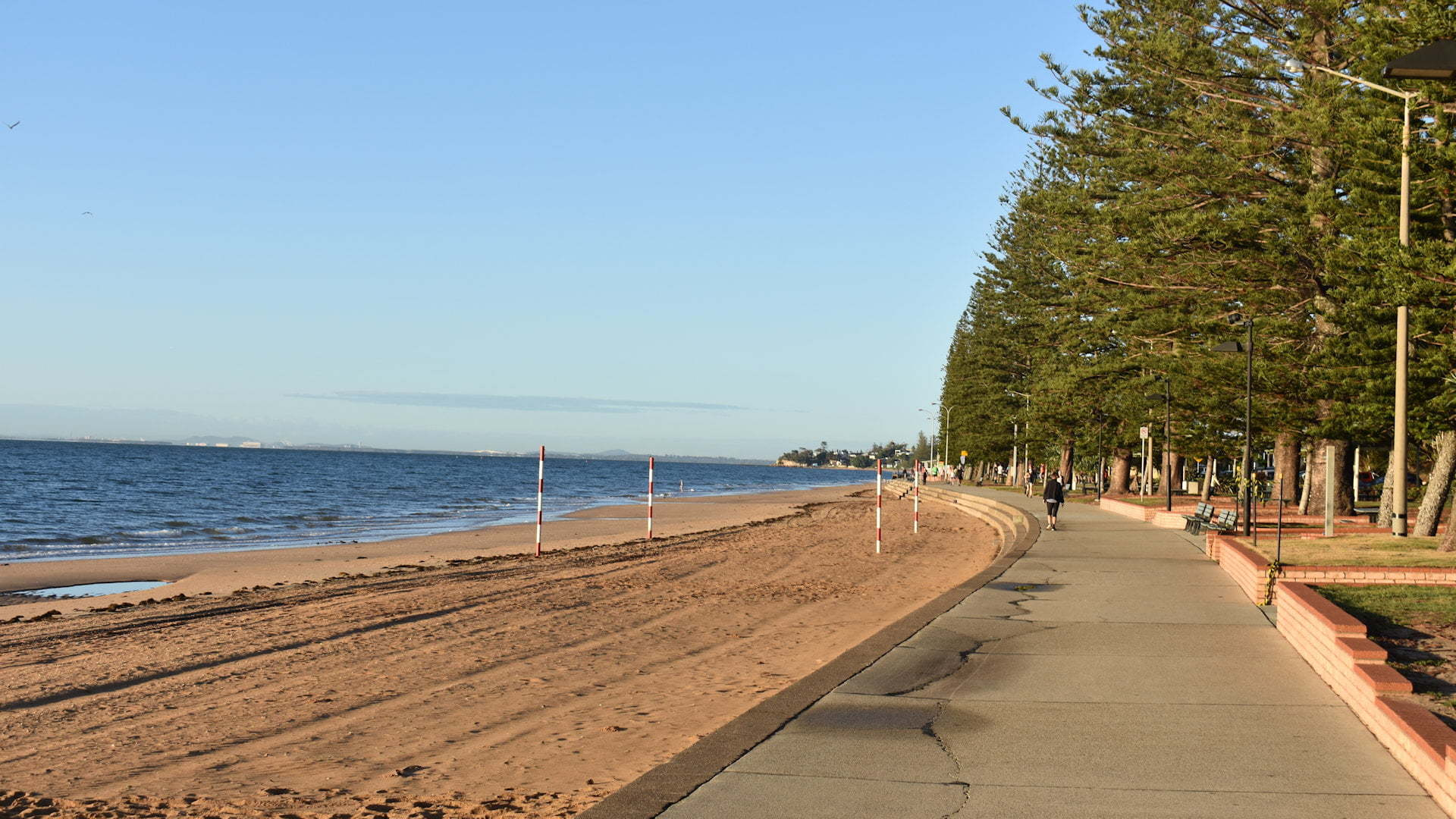 Beach with a pathway and a line of trees, taken at Suttons Beach in Redcliffe Peninsula