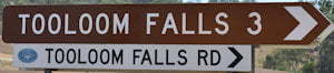 Brown sign for Tooloom Falls, 3km, white sign for Tooloom Falls Rd
