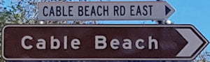 Brown sign for Cable Beach, white sign for Cable Beach Rd East