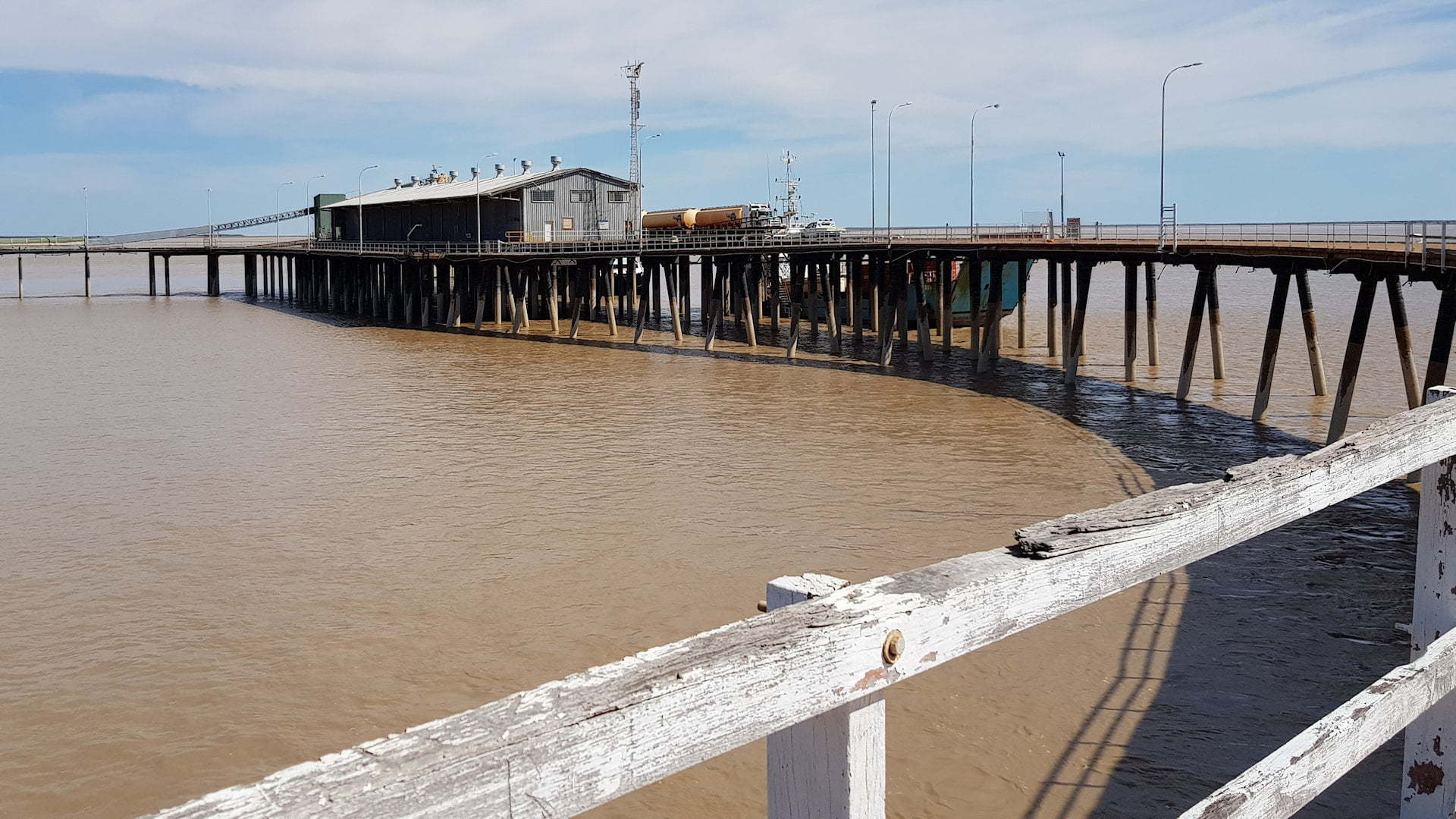 Derby Jetty with mud coloured water below it