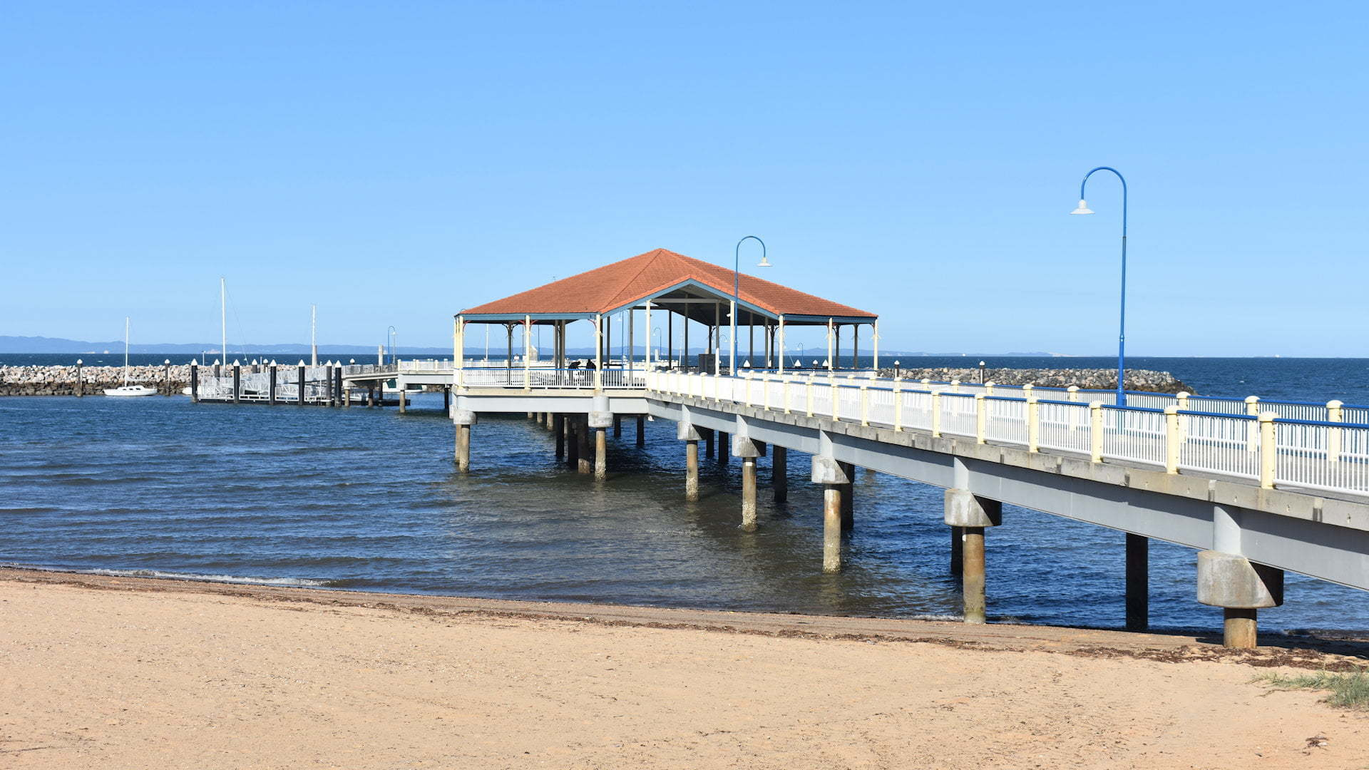 Jetty out from the beach with a rotunda part way along, taken from the sand at Redcliffe Jetty