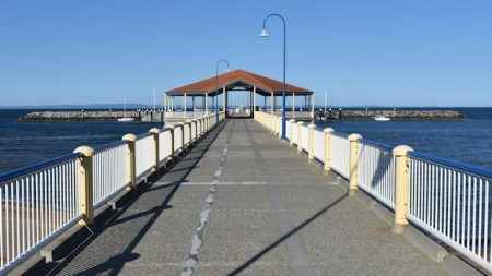 Looking down Redcliffe jetty towards to the middle pavilion, showing the lines down the centre representing the rail lines from previous versions of the jetty