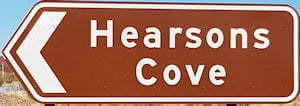 Brown sign for Hearsons Cove
