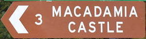 Brown sign for Macadamia Castle
