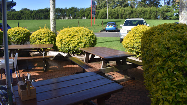 Picnic tables outside the cafe at Macadamia Castle