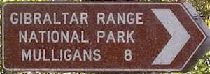 Brown sign for Gibraltar Range National Park, Mulligans, 8km