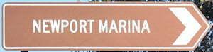 Brown sign for Newport Marina