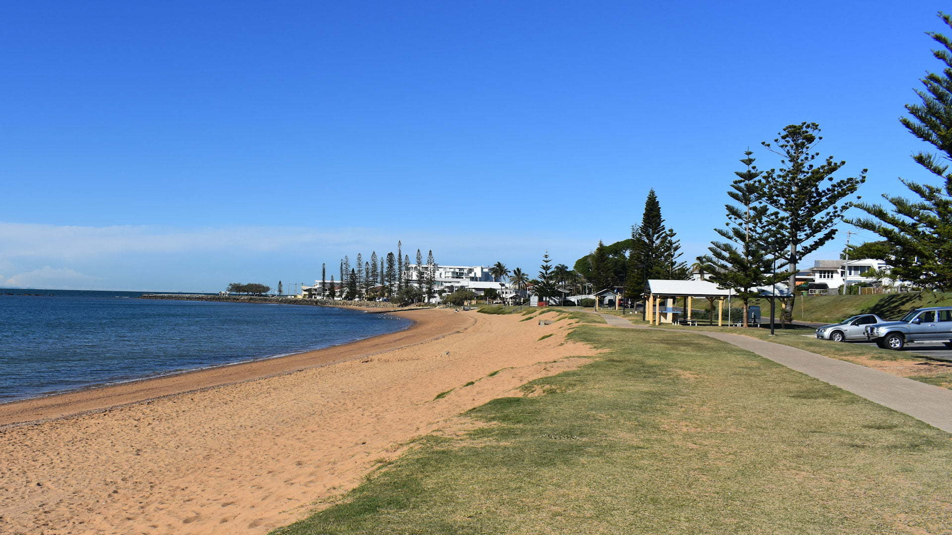 Sandy beach with grass area above it, taken at Queens Beach North on the Redcliffe Peninsula