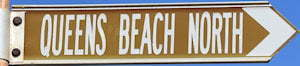 Brown sign for Queens Beach North