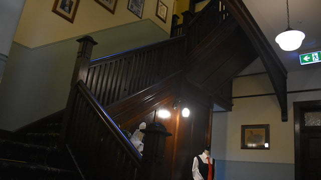 Dark wood indoors staircase, made of hoop pine in Ballina Manor