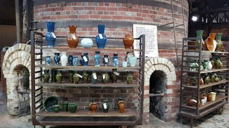 Bottle kiln at Bendigo Pottery with displays of pottery in front of it
