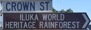 Brown sign for Iluka World Heritage Rainforest, white sign for Crown St