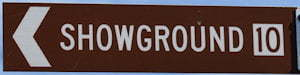 Brown sign for Showground