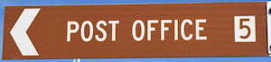 Brown sign for Post Office