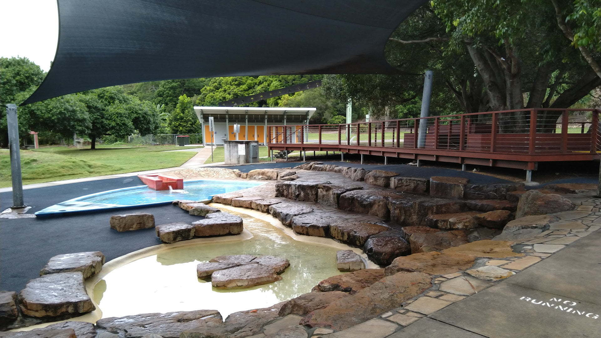 Water park and deck around a tree at Rocks Riverside Park