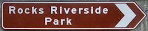 Brown sign for Rocks Riverside Park
