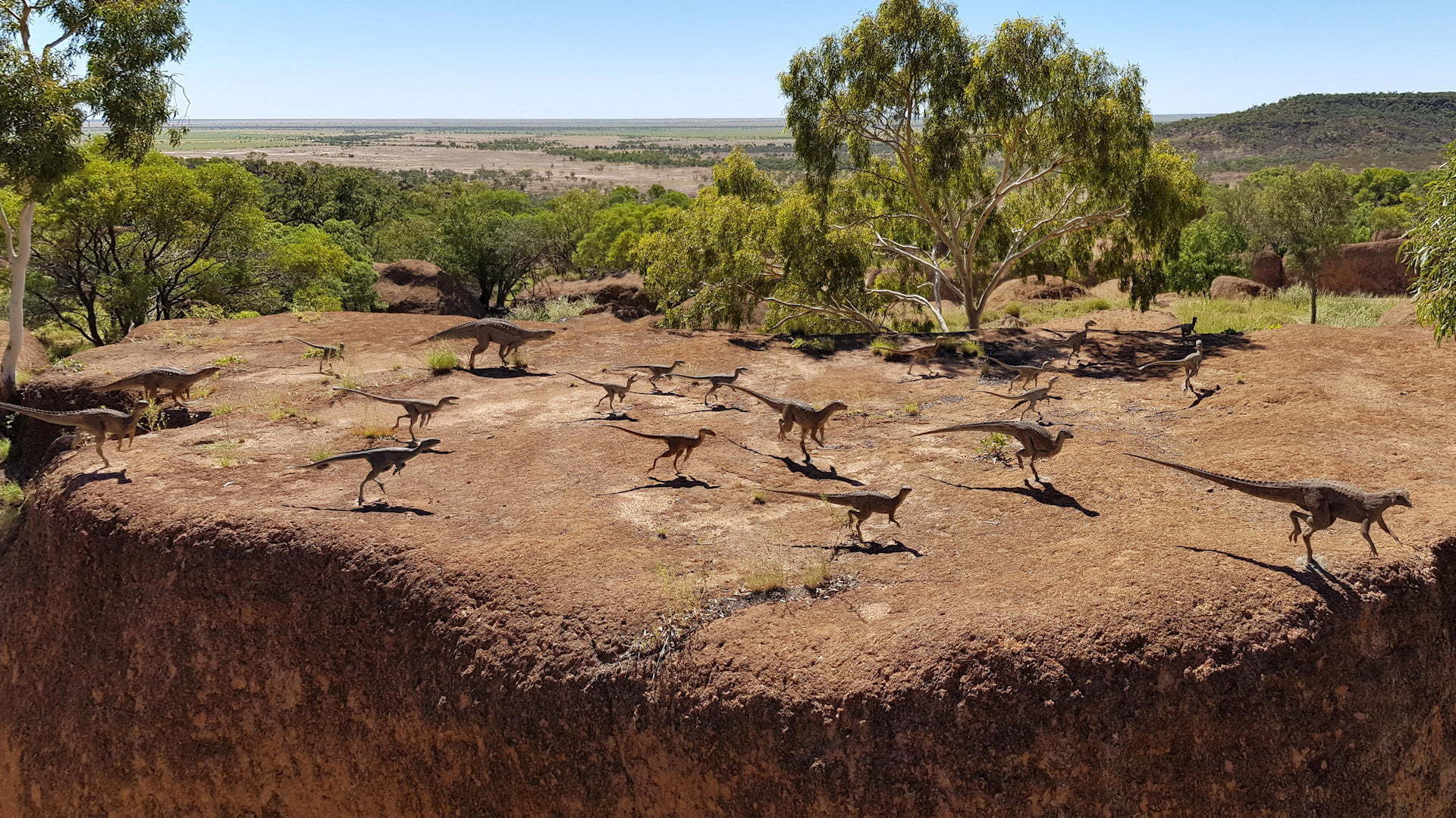 Small dinosaurs on a rock plateau in the outback, taken at the Australian Age Of Dinosaurs Museum