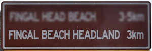 Brown sign for Fingal Beach Headland, 3km