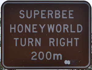 Brown sign for Superbee Honeyworld, turn right 200m