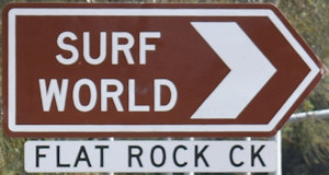 Brown sign for Surf World, while sign for Flat Rock Ck