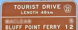 Brown sign for Bluff Point Ferry, Tourist Drive 22