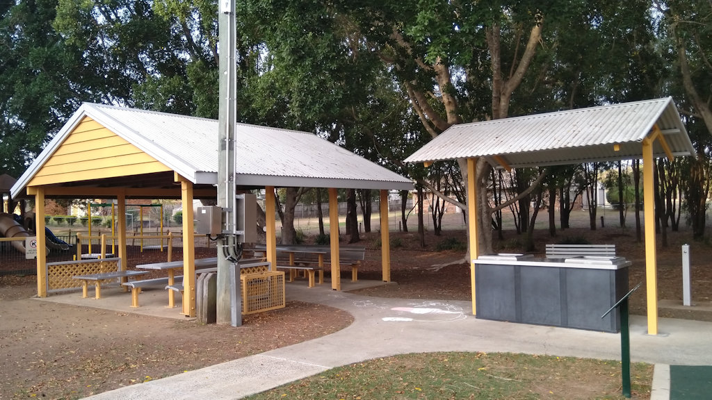 Sheltered picnic tables and free barbeque, at Johnston Park in Rosewood, Queensland