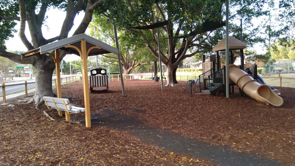 Playground in a leaf-littered shaded park, at Johnston Park in Rosewood, Queensland