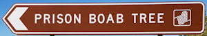 Brown sign for Prison BOAB Tree