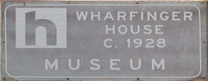 Brown sign for Wharfinger House c. 1926 Museum