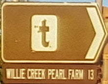 Brown sign for Willie Creek Pearl Farm, 13km