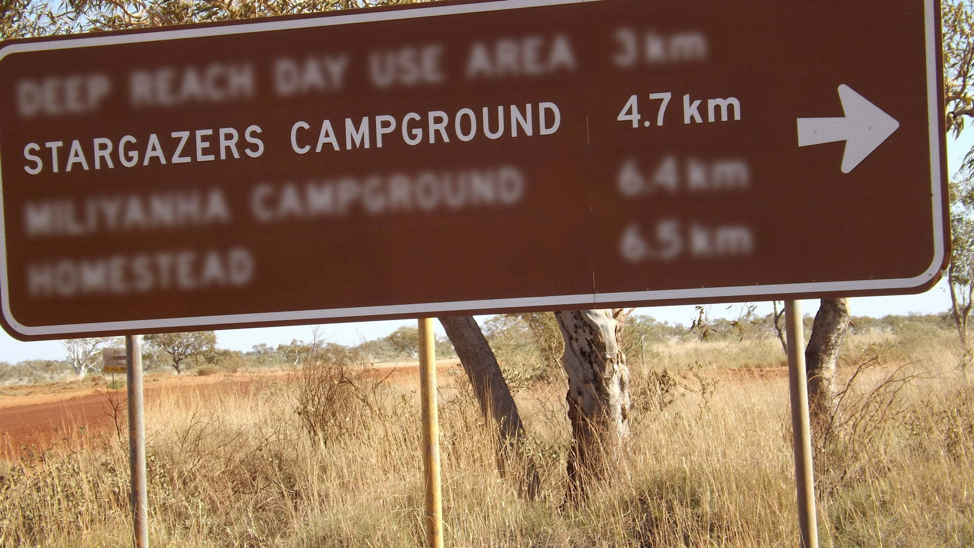Brown sign at Millstream Chichester National Park showing Stargazers Campground