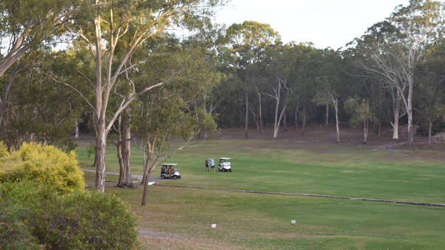 Green grass fairway surrounded by bushland