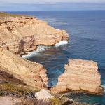 Rugged sandstone coastline with a solitary rock stack off the shoreline, taken at Island Rock in Kalbarri National Park