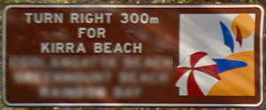 Brown sign for Kirra Beach, turn right 300m for