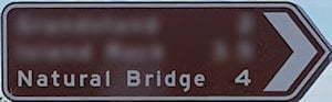 Brown sign for Natural Bridge, 4km