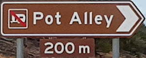 Brown sign for Pot Alley, 200m
