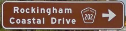 Brown sign for Rockingham Coastal Drive, Tourist Route 202, Western Australia