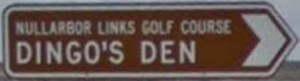 Brown sign for Nullarbor Links Golf Course Dingo's Den
