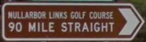 Brown sign for Nullarbor Links Golf Course 90 Mile Straight