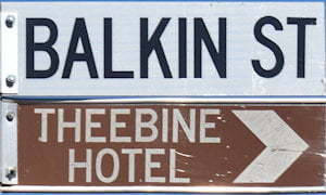 Brown sign for Theebine Hotel, white sign for Balkin St