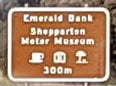 Brown sign for Shepparton Motor Museum and Emerald Bank