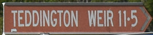 Brown sign for Teddington Weir, 11.5km