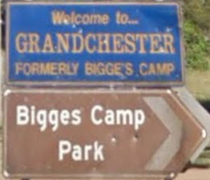 Brown sign for Bigges Camp Park, Welcome to Grandchester formerly Bigge's Camp