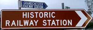 Brown sign for Historic Railway Station, blue sign for Grandchester Railway Station