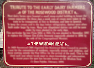 Brown sign for The Wisdom Seat