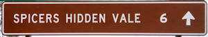 Brown sign for Spicers Hidden Vale